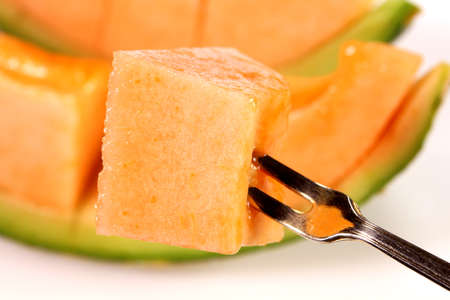 Eating cutted fresh ripe melon Banco de Imagens