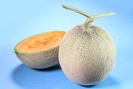 Fresh ripe melon on blue background