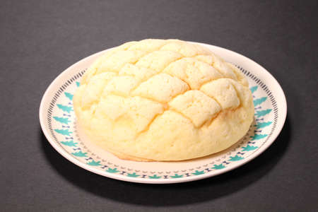 Japanese food Melon shaped bun on a plate Banco de Imagens