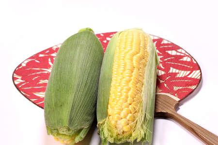 Fresh corn on cob and japanese fan