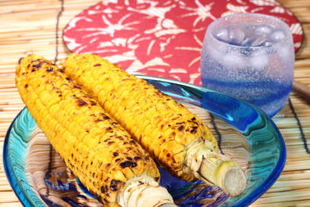 Roasted corn and glass of shochu