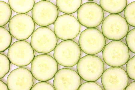 Sliced fresh cucumber on white background