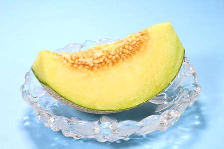 Fresh green melon on a glassware