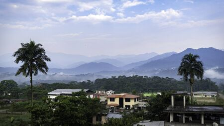 neighborhoods characteristic of the amazons in ecuador. you can see the mountains full of vegetation and the morning fog