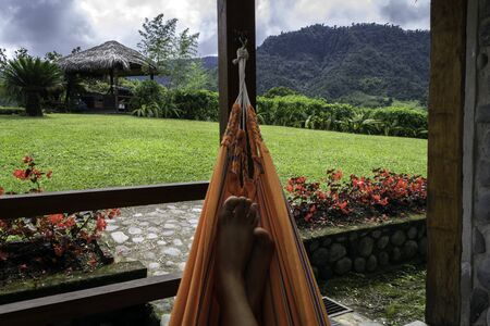 Feet of a person in a Paraguayan hammock resting, contemplating the landscape