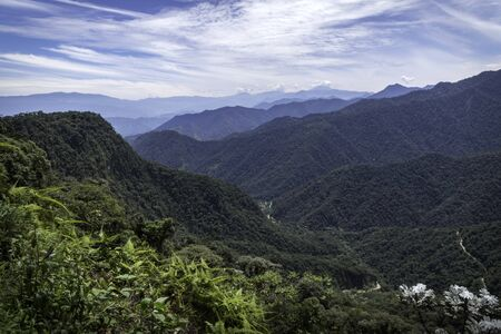 Amazing panoramic view of Bella Vista valley. You can see several mountains, hills, wild vegetation and the sky full of clouds. Mindo, Ecuador 写真素材