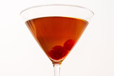 close up of a cocktail with white background, with raspberry