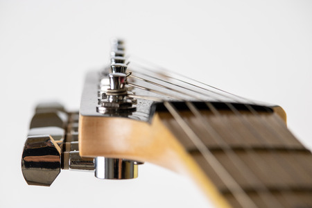 Close view of an electric guitatr headstock and tuners Stock Photo