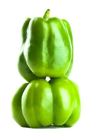 Stacked Green Bell Peppers - Isolated on White Stock Photo