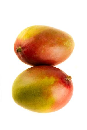 Two Stacked Mangoes - Isolated on White