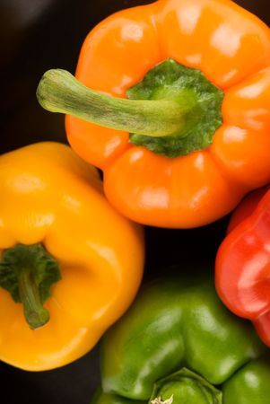 Bell Peppers on Black - Orange, Yellow, Red and Green Stock Photo - 2986565