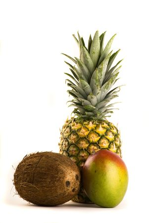 Tropical Trio - Pineapple, Mango and Coconut Isolated on White Stock Photo