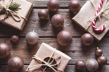 Winter holidays background. decorating christmas present, Top view on wood table Stock Photo