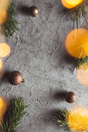 Christmas and New year decorative background border with golden toys on Christmas tree. Flat lay, top view, copy space.
