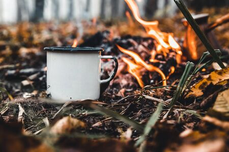 Making coffee at the stake. Make coffee or tea on the fire of nature. Burned fire. A place for fire. Ashes and coal. Stok Fotoğraf