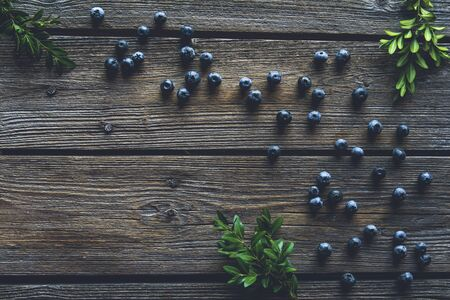 Blueberry on wooden table background. Blueberries close up. Healthy food, health Stock fotó