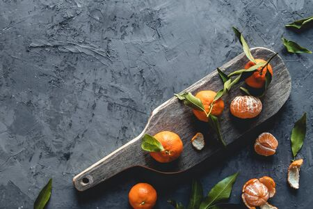 Fresh orange mandarin on wooden cutting board. eco vegetarian. PNOV2019