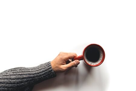 red coffee cup in hands on white background