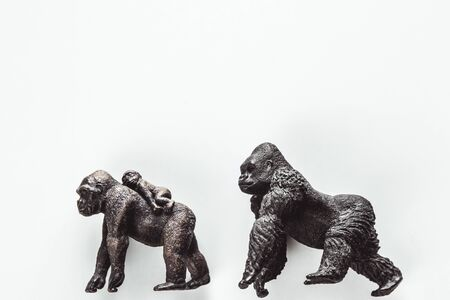 Two Toy Silver back gorilla back to back with white background