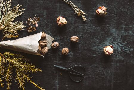 Walnuts on a old rustic table. Walnuts in a paper bag. Stock fotó