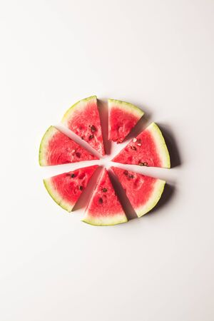 closeup of some pieces of refreshing watermelon on a white background