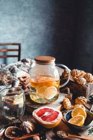 Hot tea with slices of fresh grapefruit on wooden background. Healthy drink, Eco, vegan