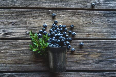 Blueberries in a Cup on a wooden background. Summer and healthy food concept.