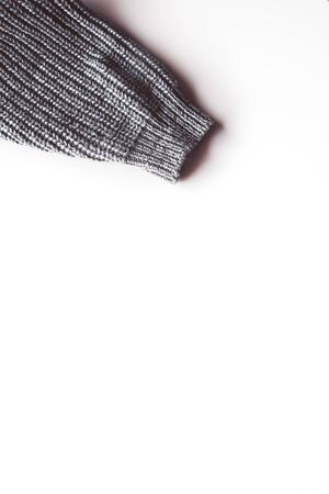 Warm knitted sleeve from a sweater with a pattern. Isolate on white. Stock fotó