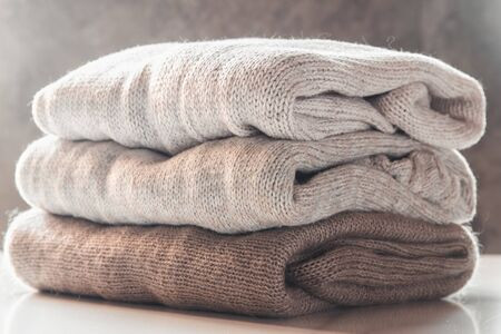 A stack of knitted sweaters ,the concept of warmth and comfort, hobby , background,closeup Stock fotó