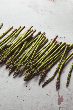 Fresh green spring asparagus on a wooden background. Asparagus season