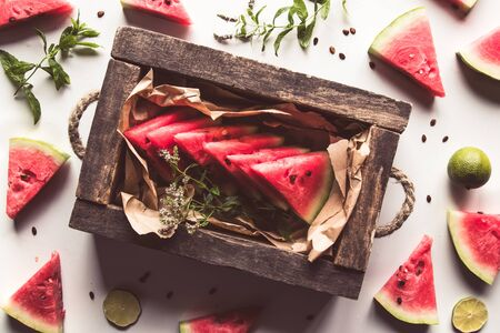 sliced watermelon with mint and lime on a white background. Fresh food. Fruits Stock fotó