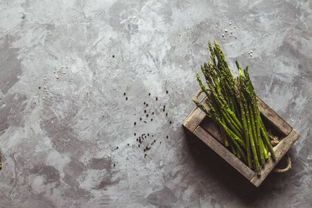 Asparagus on a cutting board. Healthy food, health on a concrete background.