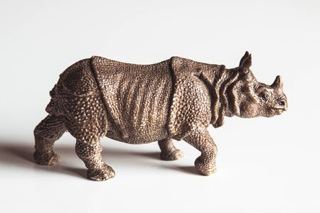 A toy rhino isolated against a white background Stock Photo