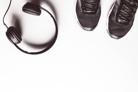 Sport background. White headphones. Copy space for text.