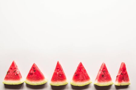 Slice of ripe and juicy watermelon , isolated on white. Top view. 스톡 콘텐츠