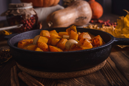Rustic roasted pumpkin in a cast iron skillet
