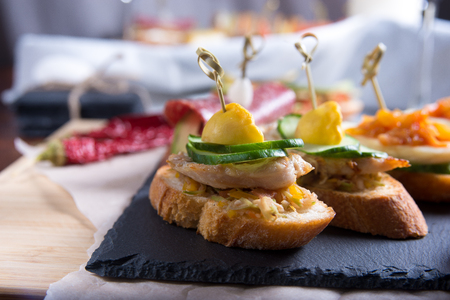 Bruschetta crostini set on a slate plate. The concept of Italian cuisine.