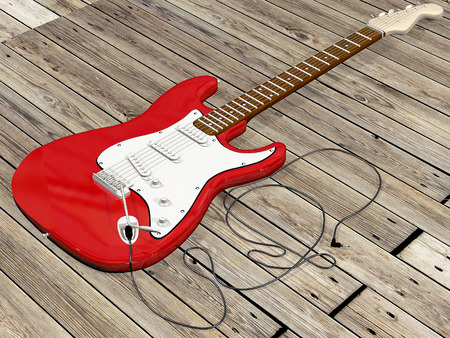 zoomed: red guitar with wooden background Stock Photo