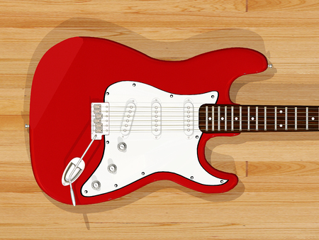 zoomed in: close up red guitar with wooden background Stock Photo