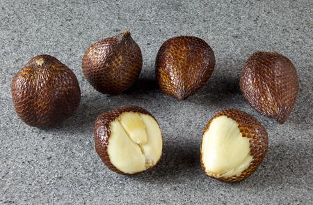 salak: Salak Fruit peeled on grey stone