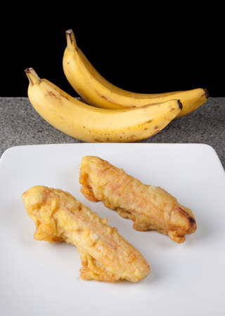 Fried Banana  Food on white plate in vertical photo