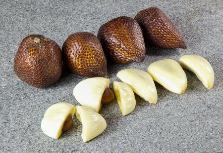 salak: Close up salak fruit sliced on grey stone