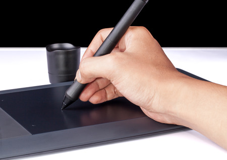 Hand holding Drawing Tablet for Graphic Designer photo