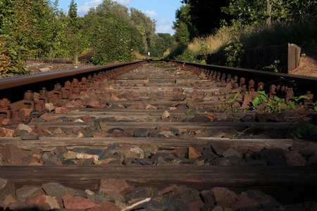 single train tracks on lost places trainstation