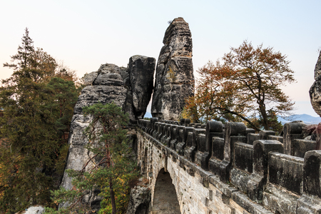 Bastei bridge national park Saxon Switzerland at Elbe Sandstone Mountains in side view. Rock formation with the rocky gate in autumn with trees Banque d'images - 123248633