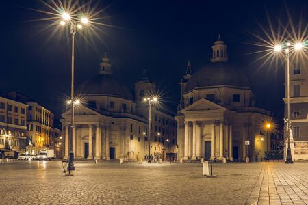 Piazza del Popolo or Peoples Square with twin churches Santa Maria di Monte Santo, Santa Maria dei Miracoli and Obelisk is one of the most famous squares in Rome heading south at night and lighting Stock Photo