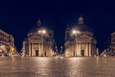 Piazza del Popolo is one of the most famous squares in Rome. The square with the double churches is illuminated at night