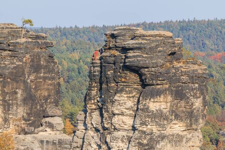 Rocks in Saxon Switzerland. Adventure for hiking and climbing near the Bastei bridge in the Elbe valley. Sunshine and blue sky with trees in autumn mood 版權商用圖片