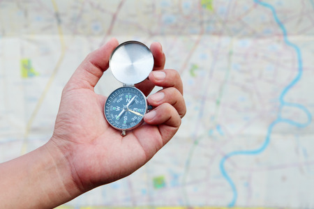 technoligy: Hand holding the compass and map
