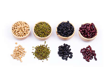 leguminous: Four types of dry beans in the wooden bowl Stock Photo